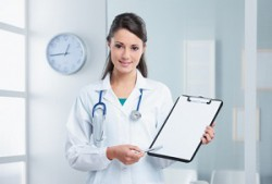 Confident woman doctor pointing at the clipboard